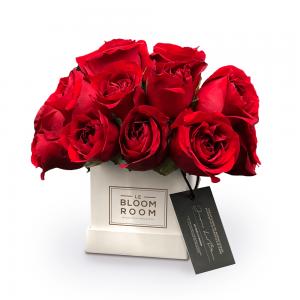 caja de rosas rojas en esfera mini